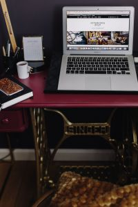 Kaboompics - Macbook Air laptop on the pink desk