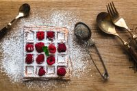 Breakfast waffles with fresh raspberries