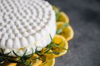 Kaboompics - Meringue Cake with whipped cream and oranges