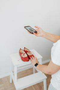 Kaboompics - Woman takes photos of products she will sell online - red shoes