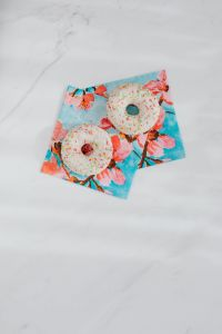 Kaboompics - Donuts on paper napkins placed on white marble
