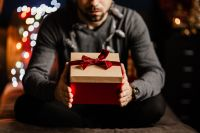 Kaboompics - A handsome man with Christmas presents