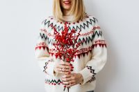 Kaboompics - Woman in a white Christmas sweater holds rowanberry branch