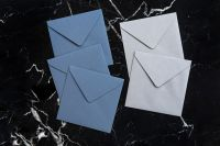 Kaboompics - Blue & white envelopes on marble