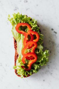 Breakfast sandwich with hummus - lettuce - sweet pepper - cucumber