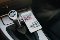 Kaboompics - Modern car interior with smart phone on manual gear stick