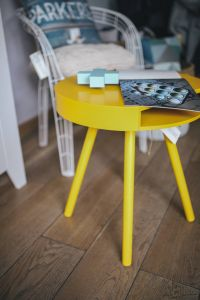 Kaboompics - Designer magazine on a yellow table