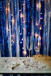 Kaboompics - New Year's Eve - champagne glasses on a blue background