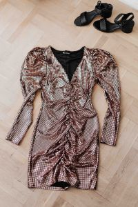 Kaboompics - gold rose sequin dresses and boots lie on a wooden parquet,