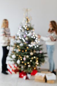 Kaboompics - Women Decorate Christmas Trees