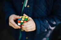 Kaboompics - Boy in a blue jacket holding a rubik's cube
