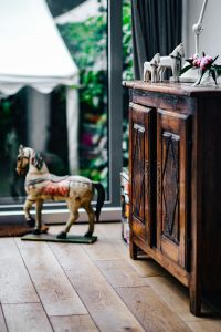 Kaboompics - Vintage wooden furniture and horse sculptures