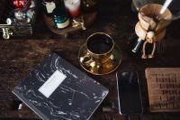 Kaboompics - Notebook, cup of coffee, glasses, Chemex, keyboard, iPhone