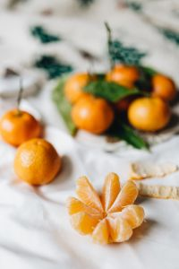 Kaboompics - Still life of mandarin oranges with leaves