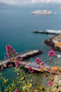 View of the sea, yacht and umbrella pier in Sorrento, Italy