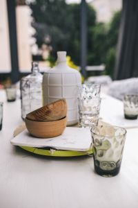 Kaboompics - Glasses and jars on a white garden table