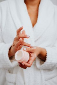 Kaboompics - A middle-aged woman applying hand cream