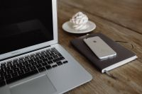 Kaboompics - Silver Apple MacBook Pro with a meringue, smartphone and a notebook on a table