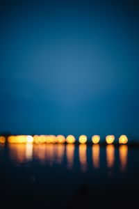 Kaboompics - Blurred city lights reflected in the water at night