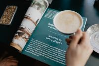 Kaboompics - Reading a magazine & drink a coffee late