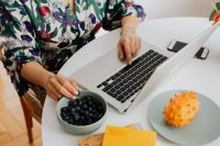 Kaboompics - Woman, MacBook laptop, blueberries, kiwano fruit