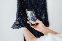 Woman takes photos of products she will sell online - dress