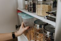 Kaboompics - Containers of cereals in kitchen cupboard