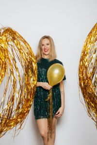 Kaboompics - Woman in Green Dress holding balloon on a white Background