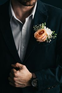 Kaboompics - A man in a suit with flowers in a Boutonnière
