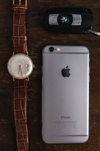 Kaboompics - Apple iPhone 6, Vintage watch on a brown leather wallet, BMW car key