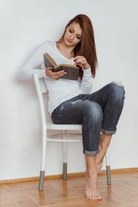 Kaboompics - Beautiful young woman reading a book