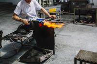 Glassworker in action in the Murano glass factory