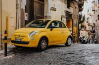 Kaboompics - Yellow modern little car, Fiat 500, parked on a street in Naples
