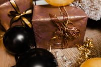 Kaboompics - New Year's Eve party - closeup of gift with ribbon