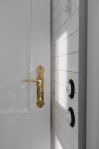 Kaboompics - Antique gold plated door handle & light switch