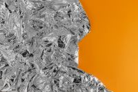 Kaboompics - Silver Foil Texture & Orange Background