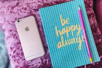 Kaboompics - Blue notebook with a pink iPhone and a pencil