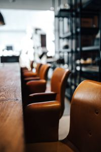 Kaboompics - Row of Leather Dining Chairs Primum - Bent Hansen