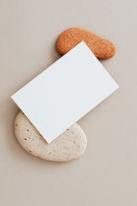 Kaboompics - Blank card & rocks on beige background