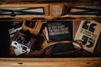 Kaboompics - Books in a drawer & Vintage camera
