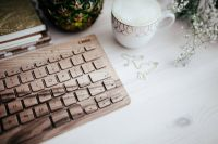 Kaboompics - Wooden keyboard and cup of coffee