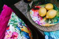 Lemons on colorful plate, tropical pillows