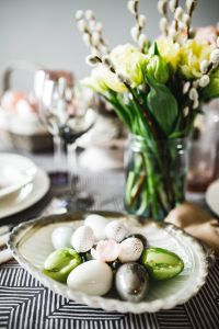 Kaboompics - Round dinner table decorated with easter motifs