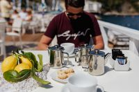 Kaboompics - Cups, silver jugs with coffee, Italian cookies and lemons on the table