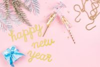 New Years Eve party decorations on pink background