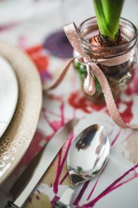 Kaboompics - Utensils and a small plant on an easter table