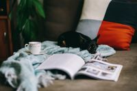 Kaboompics - Resting with magazine and cute puppy