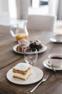 Kaboompics - Sweet dessert with cream and a cup of coffee on a table