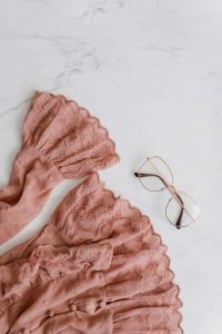 Kaboompics - Blouse in pale pink colour made of thin chiffon with frills