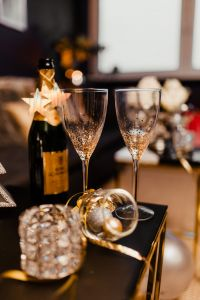 New Year's Eve party - open bottle of champagne and glasses